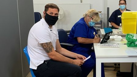 Grant Holt visited Attleborough vaccine centre to get his jab – and encourage others to do the same.