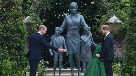 The Duke of Cambridge (left) and Duke of Sussex unveiling a statue they commissioned of their mother
