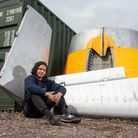 Phil Noble with some of the decommissioned aircraft pieces that will be used by DappR Aviation. Pic