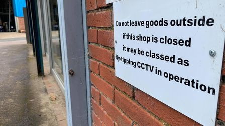 The sign outside The Salvation Army Furniture Store, warning people not to leave goods outside the shop.