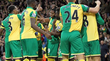 The Norwich City players celebrate Jonny Howson's winning goal against Swansea. Picture: Paul Cheste