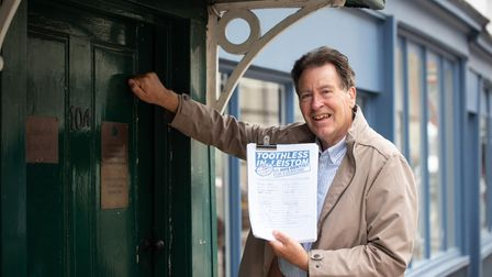 Steve Marsling delivering a petition over lack of Suffolk dental provision to Jo Churchill's office