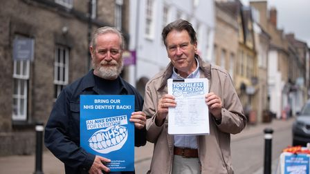 Phil Katz and Steve Marsling delivering a petition over lack of Suffolk dental provision to Jo Chur