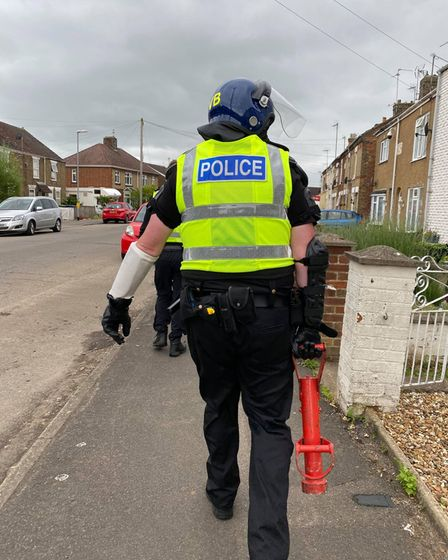 Drugs, cash, and a knife were seized during two police raids in March.