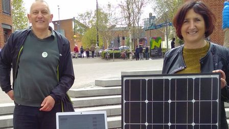 Cllr Lucy Galvin witha solar panel at an Earth Day event at The Forum, Norwich