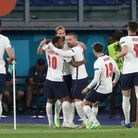 England's Harry Kane (centre) celebrates scoring their side's first goal of the game during the UEFA