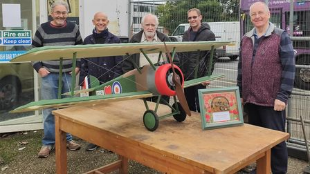 Members of Norwich Men's Shed with a model Sopwith Camel they made.