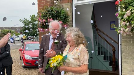 Friends and family celebrate Peter and Dorothy Bane's wedding day.