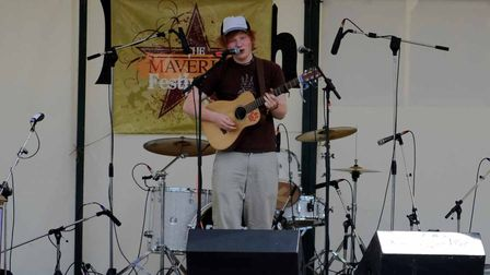 A then unknown Ed Sheeran playing at Maverick Festival at Easton Farm Park in 2009