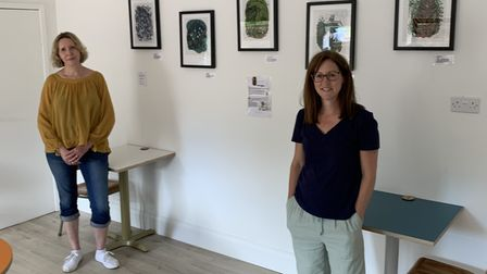 From left, printmaker Karin Klompe and Milk Shed Café co-owner Clare Forrest at the launch of the art show