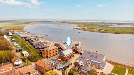 Aerial view of Orford Quay with blue graphic arrow showing property for sale