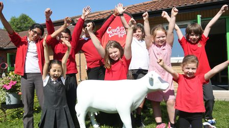 Mini Moo enjoys a visit to The Spinney primary school in Cambridge. .