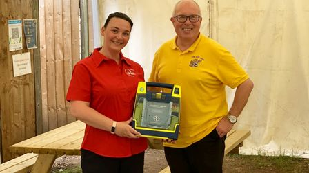 Lucy Pye and Paul Simpson at The Dun Cow pub in Christchurch with a defibrillator