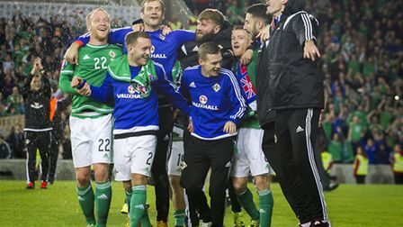 Kyle Lafferty, right, joins his Northern Ireland team-mates as they celebrate qualification for Euro