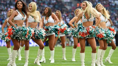 Miami Dolphins cheerleaders entertain the crowd during the NFL International match at Wembley Stadiu
