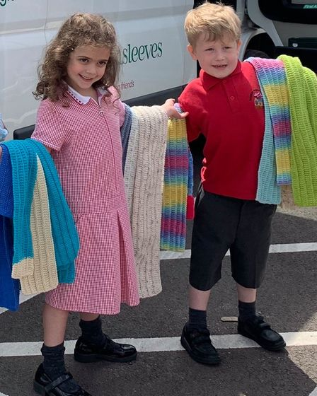 Darcie and James, pupils at Roydon Primary School, weredelighted to receive knitted by residents at De Lucy House in Diss