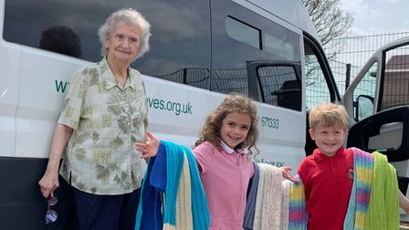Elsie Weston, 88, resident at De Lucy House in Diss, delivered scarves to Roydon Primary School pupils Darcie and James