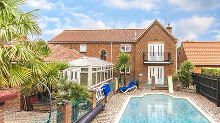 Large brick-built family home with Juliet balcony overlooking tropical gardens and outdoor pool