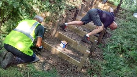 Dereham Walkers are Welcome and Ramblers volunteers repairing the sets of steps near the A47