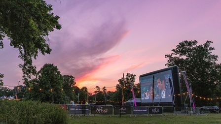 The sun sets over the Sandringham Estate as cinema goers watch an open-air screening of Grease