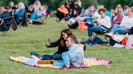 The sun sets over The Sandringham Estate as cinema goers watch an open-air screening by of Grease.