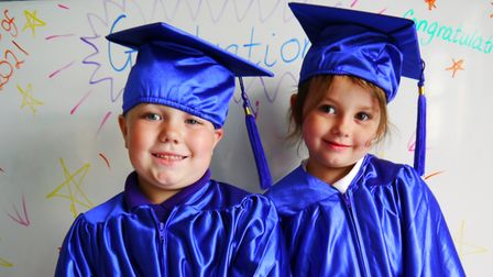 Swaffham CofE Primary Academy reception pupils Joey and Arianna in their graduation gowns.