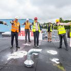 staff join together for topping out ceremony;