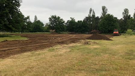 To help prepare the church field for rugby , the club is buying and importing at least four hundred tonnes of top soil