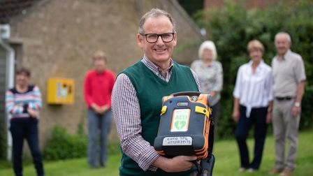 Andy Read with his neighbours who all pitched in for a defib for their road. Picture: Sarah Lucy B