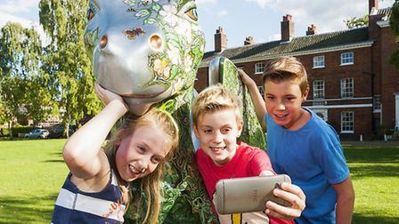 Oscar, Honey and Arthur Pope on the GoGo dragon trail in Catherdal Close.