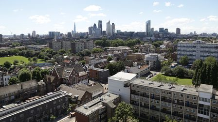 Social housing in Bethnal Green, east London, contrasts with the buildings in The City of London in