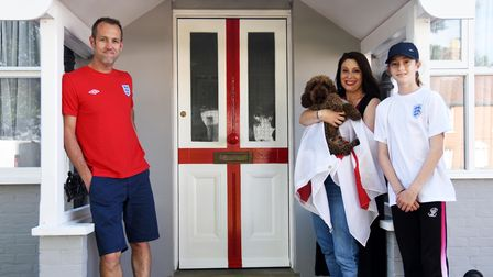 Rob, Bronwyn, Bev and Teddy have painted their front door into an England flag for the Euros.