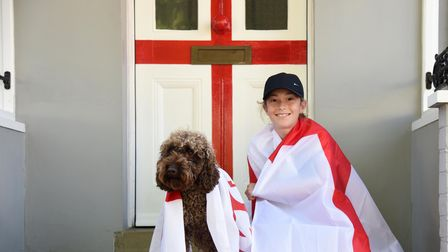 Robert, Bronwyn, Bev and Teddy have painted their front door into an England flag for the Euros PIc