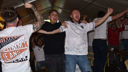 England v Denmark at The Railway Tavern in Dereham Fans celebrate the team going through to the fina