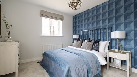 One of four luxurious bedrooms found in the Ashdown home, which has a natural feel