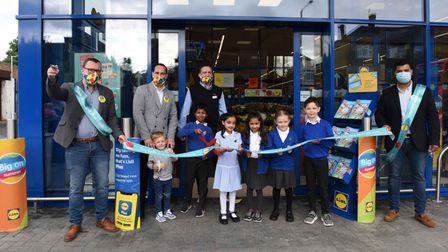 Local school children together with members of staff opening the new Lidl store in Becontree Heath