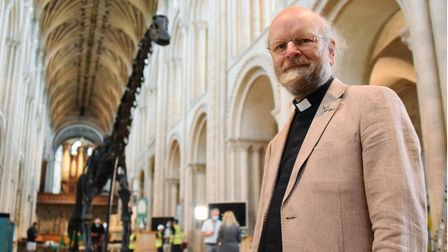 Project manager, Rev Canon Andy Bryant, with Dippy the Diplodocus at Norwich Cathedral. Picture: DEN
