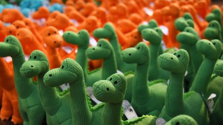 Cuddly dinosaur toys ready for the shop as Dippy the Diplodocus arrives at Norwich Cathedral.