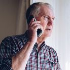 Fraudsters have been cold-calling people in Norfolk, claiming to be police officers to con their victims out of money.
