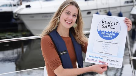 Ella Wilkinson with the Water Safety Campaign poster, for water safety awareness. Picture: DENISE BR