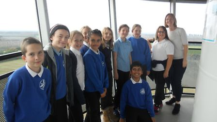 Pupils at the top of the wind turbine with teacher Laura Newark.