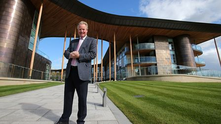 David Sheepshanks poses for photos outside the hotel during a media tour of St Georges' Park Footbal