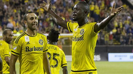 Kei Kamara collects his Columbus Crew 2015 Golden Boot award, with wife Kristin and their daughter.