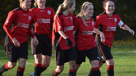 Wymondham team Celebration following a goal from Leah Newcombe vs Thorpe, from left, Sally Hammerton