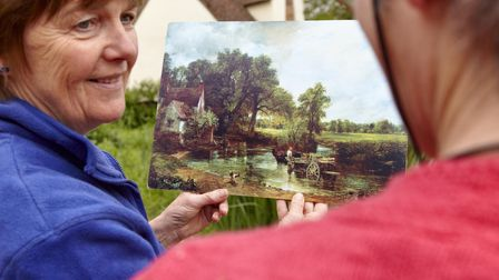 Visitors comparing Constable's paintings to the scene at Flatford, Suffolk.