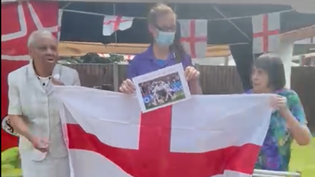 Residents and staff at Hanbury Court Care Home in Dagenham sing in support of England ahead of the Euro 2020 final.