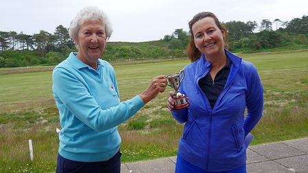 Carole Brailey presenting Sally Underwood, winner of the nett competition, with her Cup