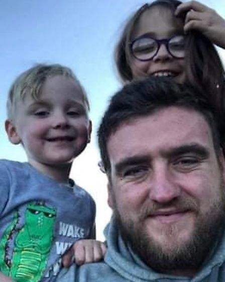 """Connor with two ofhis children, Herron and Beau. His children """"were his world""""."""