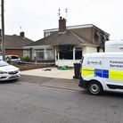 Police and Forensic Services officers at the scene of the house blaze on Saturday.