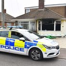 Police at the scene of the house blaze in Bradwell on Saturday.
